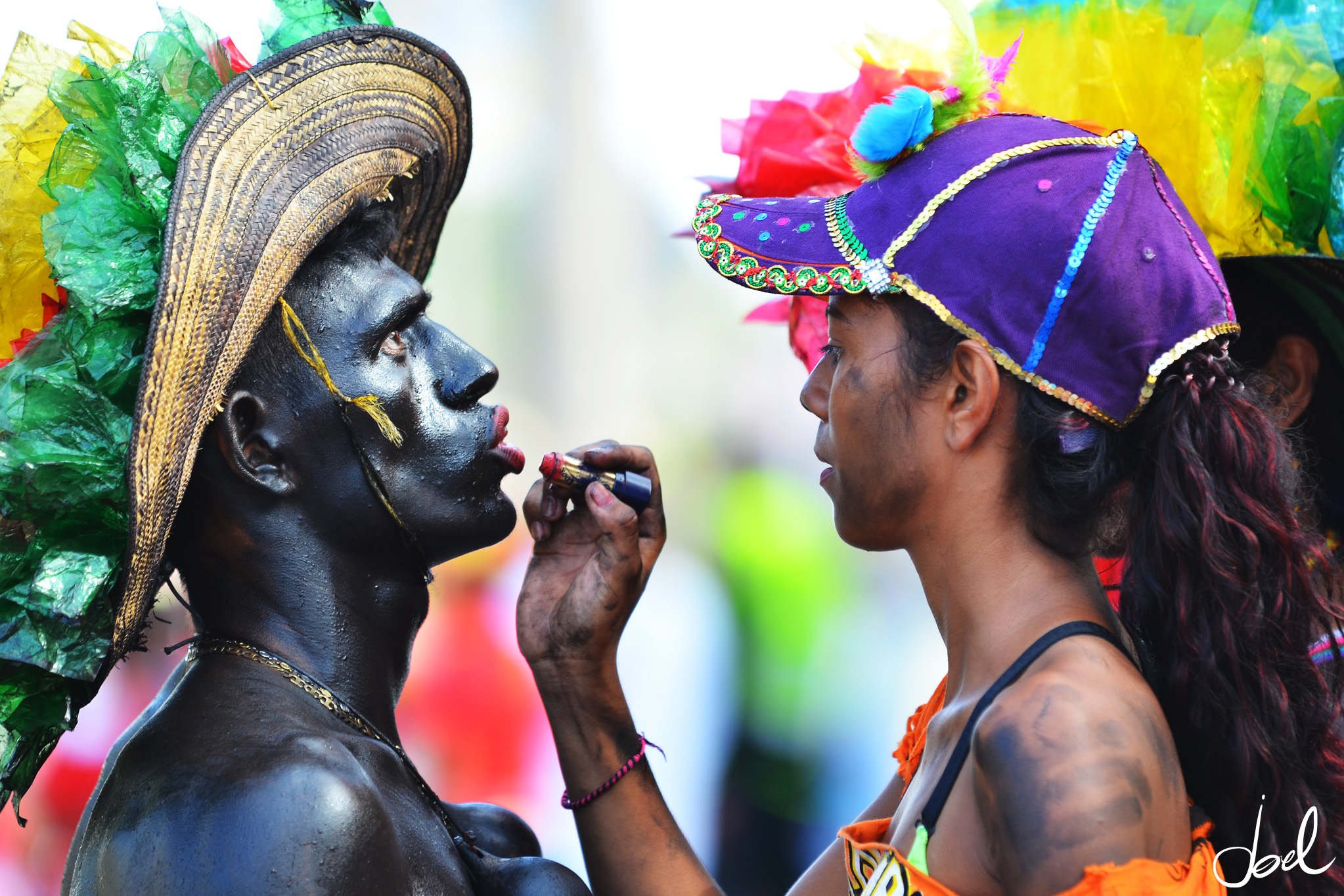 Reveler receives a finishing touch before taking part in the Flower Parade (Photo: Joel Duncan)