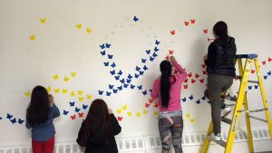 Colombians in New York paint a mural to commemorate the war victims (Image credit: El Periodico Hispano)